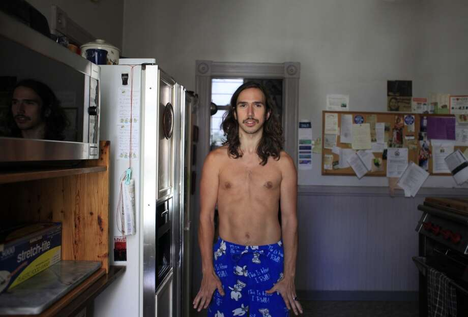 "Ready for the day, Travis ""Topless Travis"" Sigley stands in his San Francisco kitchen."