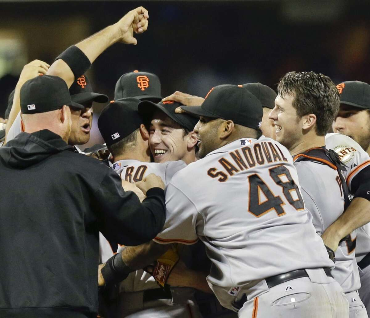 The San Francisco Giants celebrate after the no-hitter thrown by Tim Lincecum, center, against the San Diego Padres in San Diego on Saturday, July 13. The Giants won the game 9-0.