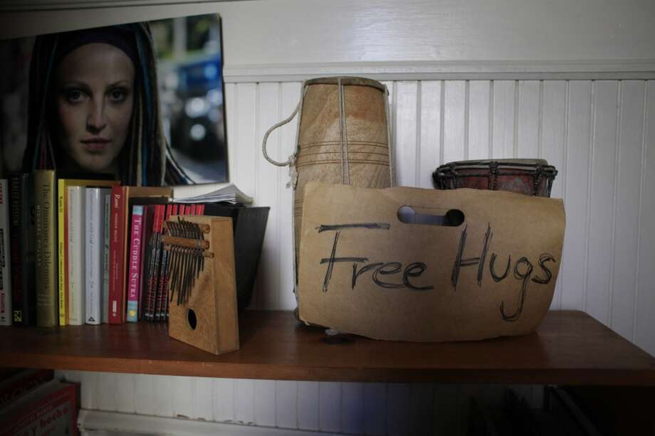 "A sign offering free hugs rests outside Travis ""Topless Travis"" Sigley's room in his San Francisco home."