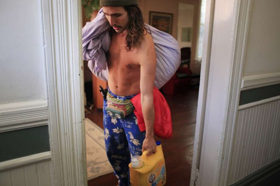 "Loaded up with laundry, Travis ""Topless Travis"" Sigley   prepares to head to the laundromat near his home in San Francisco."