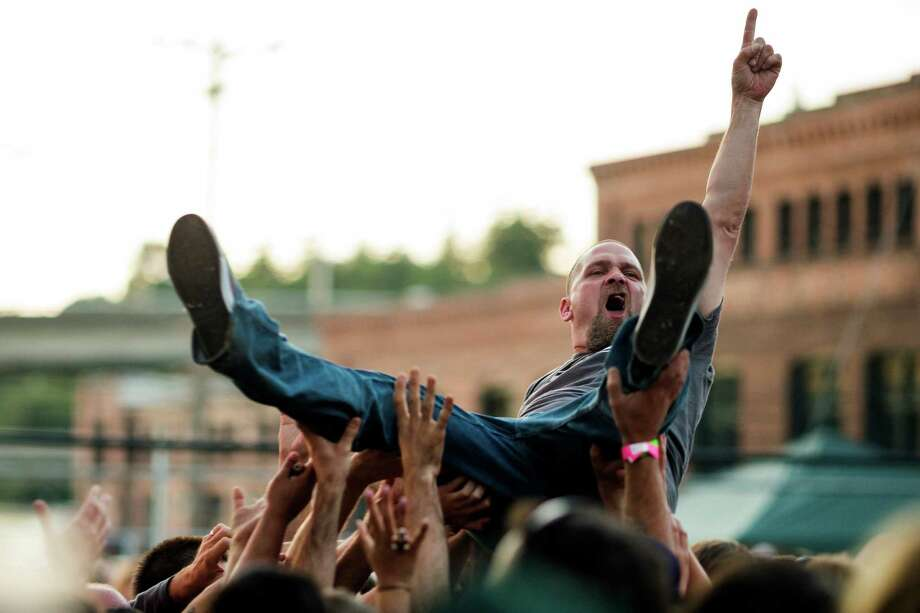 A crowd surfing attendee enjoys a performance by Built to Spill during Sub Pop's Silver Jubilee Saturday, July 13, 2013, in the Georgetown neighborhood of Seattle. The free event commemorated 25 years of existence for the Seattle-local label. Photo: JORDAN STEAD, SEATTLEPI.COM / SEATTLEPI.COM