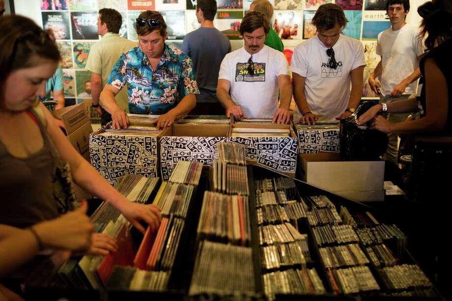 Attendees rifle through albums in the Sub Pop Megamart during the label's Silver Jubilee Saturday, July 13, 2013, in the Georgetown neighborhood of Seattle. The free event commemorated 25 years of existence for the Seattle-local label. Photo: JORDAN STEAD, SEATTLEPI.COM / SEATTLEPI.COM