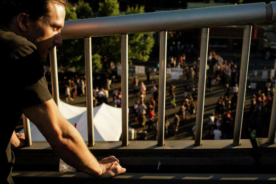 A man watches Rose Windows perform during Sub Pop's Silver Jubilee Saturday, July 13, 2013, in the Georgetown neighborhood of Seattle. The free event commemorated 25 years of existence for the Seattle-local label. Photo: JORDAN STEAD, SEATTLEPI.COM / SEATTLEPI.COM
