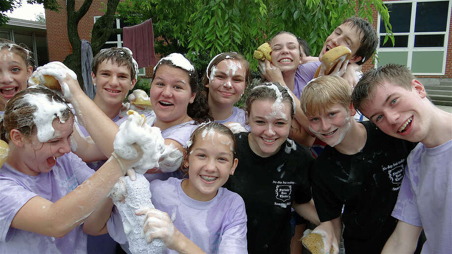They're all wet -- and soapy, too -- at Saturday's car wash sponsored by the Fairfield Teen Theatre's acting troupes. Photo: Mike Lauterborn / Fairfield Citizen contributed