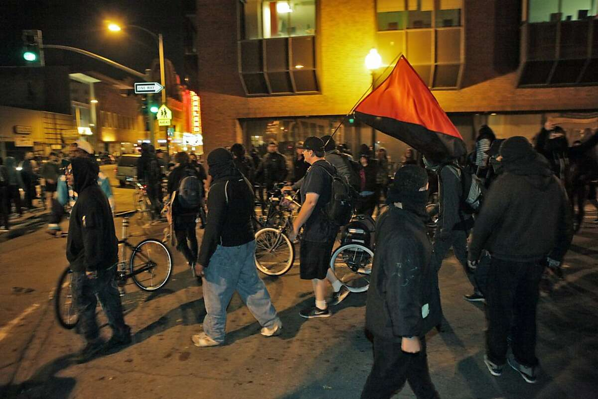 Protesters amass at 17th Street and Telegraph Avenue as they set fires and vandalized stores in downtown Oakland.