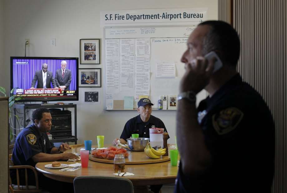 (l to r) Firefighters, Kenny Martin, Jay Lee and Meir Gordon, break for lunch at Fire Station #1 at SFO in San Francisco, Calif., on Friday July 12, 2013. The San Francisco firefighters at Station #1 were the second unit on the scene of the crash of Asiana Airlines flight 214 at SFO last Saturday July 6, 2013.