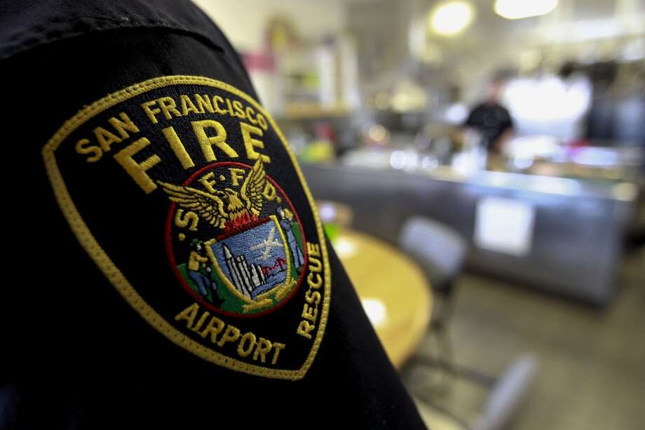 Firefighters break for lunch at Fire Station #1 at SFO in San Francisco, Calif., on Friday July 12, 2013. The San Francisco firefighters at Station #1 were the second unit on the scene of the crash of Asiana Airlines flight 214 at SFO last Saturday July 6, 2013.