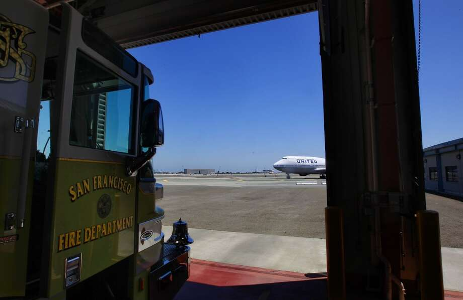 A jumbo jet passes by Fire Station #1 at SFO in San Francisco, Calif., on Friday July 12, 2013. The San Francisco firefighters at Station #1 were the second unit on the scene of the crash of Asiana Airlines flight 214 at SFO last Saturday July 6, 2013.