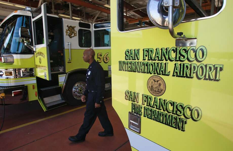 Firefighter Lt. David Brown walks through the garage at Fire Station #1 at SFO in San Francisco, Calif., on Friday July 12, 2013. The firefighters at Station #1 were the second unit on the scene of the crash of Asiana Airlines flight 214 at SFO last Saturday July 6, 2013.