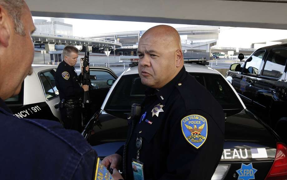 Officer Stuart Molver, (left),  Officer James Cunningham,(center) and Lt. Gaetano Caltagirone starting their early morning shift at SFO on Saturday July 13, 2013, in San Francisco, Calif. San Francisco police officers working at the International terminal police station were among the first on the scene of the crash-landing of Asiana Airlines flight 214 last Saturday July 6, 2013.