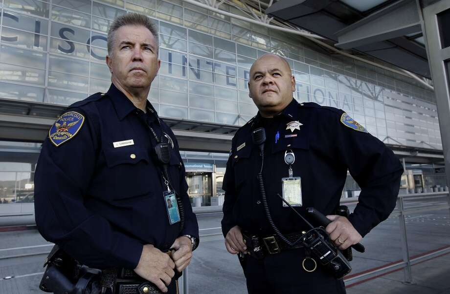 Officer James Cunningham, (left) Lt. Gaetano Caltagirone, at the International terminal as they start their early morning shift at SFO on Saturday July 13, 2013, in San Francisco, Calif. San Francisco police officers working at the International terminal police station were among the first on the scene of the crash-landing of Asiana Airlines flight 214 last Saturday July 6, 2013.