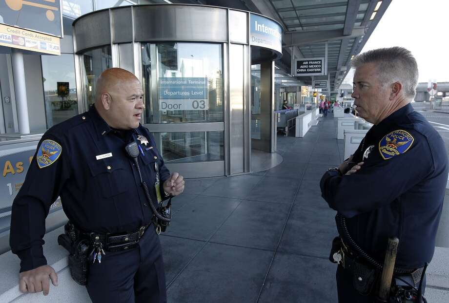 Lt. Gaetano Caltagirone, (left) and Officer James Cunningham, at the exterior of the International terminal as they start their early morning shift at SFO on Saturday July 13, 2013, in San Francisco, Calif. San Francisco police officers working at the International terminal police station were among the first on the scene of the crash-landing of Asiana Airlines flight 214 last Saturday July 6, 2013.