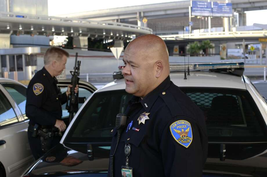Officer James Cunningham, (left) and Lt. Gaetano Caltagirone just starting their early morning shift at SFO on Saturday July 13, 2013, in San Francisco, Calif. San Francisco police officers working at the International terminal police station were among the first on the scene of the crash-landing of Asiana Airlines flight 214 last Saturday July 6, 2013.