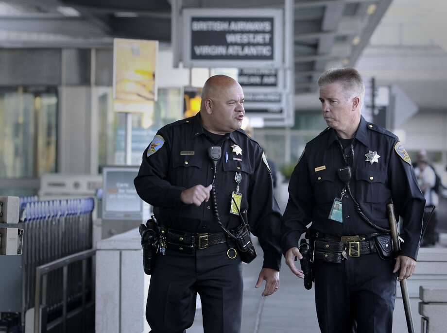In this file photo, Lt. Gaetano Caltagirone, (left) and Officer James Cunningham,  walk the exterior of the International terminal as they start their early morning shift at SFO on Saturday July 13, 2013, in San Francisco, Calif. Officers throughout the Bay Area were on heightened alert Sunday, Aug. 4, 2013, following a global travel advisory.