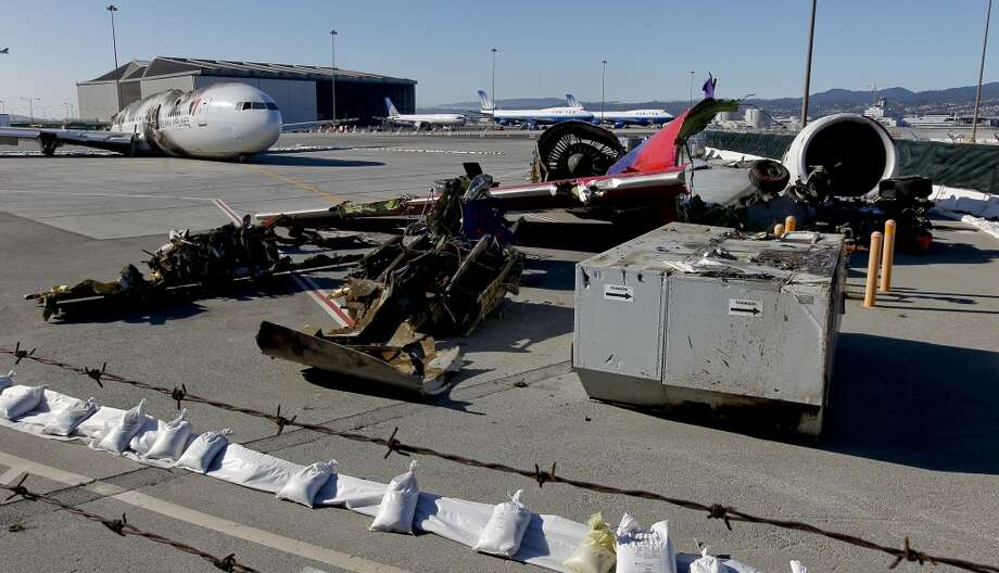 The remains of Asiana Airlines flight 214, as seen on Saturday July 13, 2013, in San Francisco, Calif. The aircraft and many parts have been moved to the north end of San Francisco International Airport.