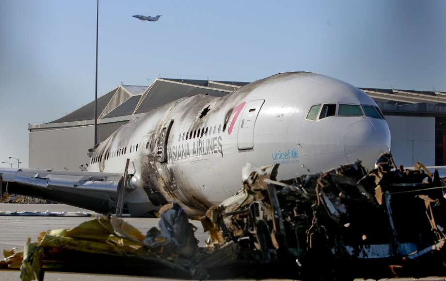 The remains of Asiana Airlines flight 214, as seen on Saturday July 13, 2013, in San Francisco, Calif. The aircraft has been moved to the north end of  San Francisco International Airport.
