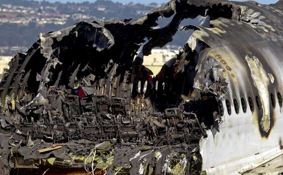 The burned interior of Asiana Airlines flight 214, as seen on Saturday July 13, 2013, in San Francisco, Calif. The aircraft has been moved to the north end of at San Francisco International Airport.
