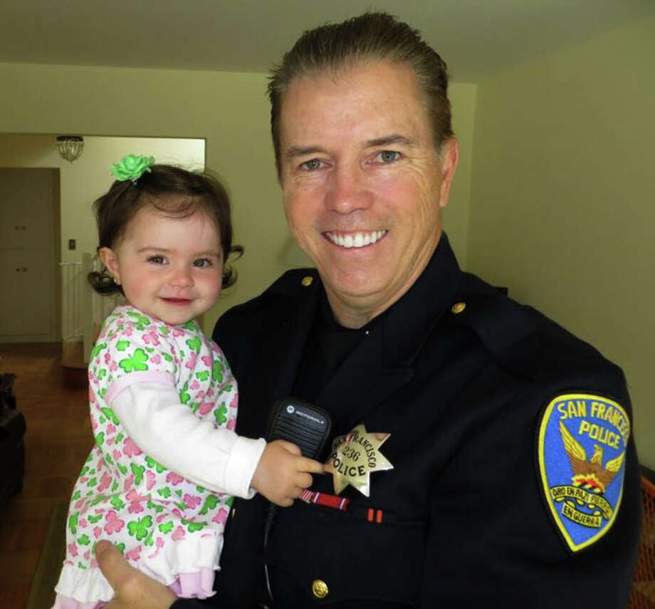 San Francisco Police officer James Cunningham with his 18 month old Daughter Ashlyn. Officer Cunningham was one of the first officers to arrive on the scene of last weeks crash-landing of Asiana Airlines flight 214 at SFO.          Photo courtesy: Cunningham Family Photo: Cunningham Family / ONLINE_YES