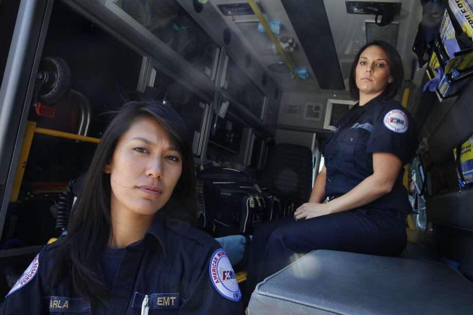 American Medical Response emergency medical technicians Karla Louie (l to r) and Maleah Goodreau are seen in an ambulance at the American Medical Response San Francisco operation on Friday, July 12, 2013 in San Francisco, Calif.