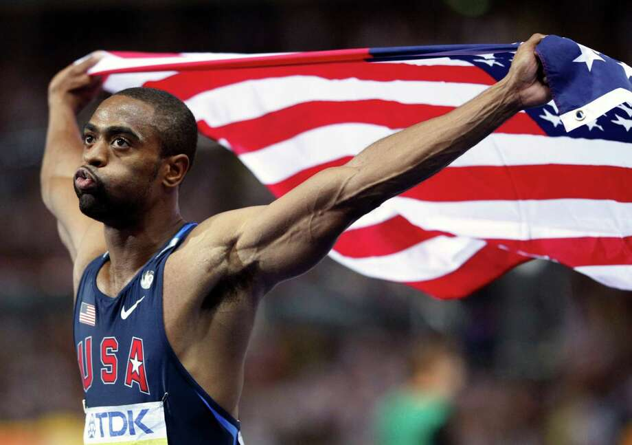 FILE - In this Aug. 16, 2009 file photo, United States' Tyson Gay who placed second celebrates with the U.S. flag after the Men's 100m final during the World Athletics Championships in Berlin. Gay said Sunday, July 14, 2013 that he tested positive for a banned substance and that he will pull out of the world championships next month in Moscow. Photo: Anja Niedringhaus