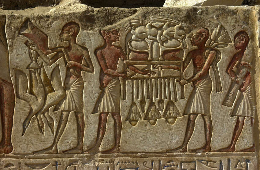 Very well preserved engravings showing ancient Egyptians making offers to sun god Aten, can be seen on one of the walls of the tomb of an ancient Egyptian priest dating to the mid-14th century BC, that has been discovered near the Sakkara pyramids in the outskirts of Cairo, Tuesday Feb. 13, 2001. Dutch archeologists discovered the burial last January.
