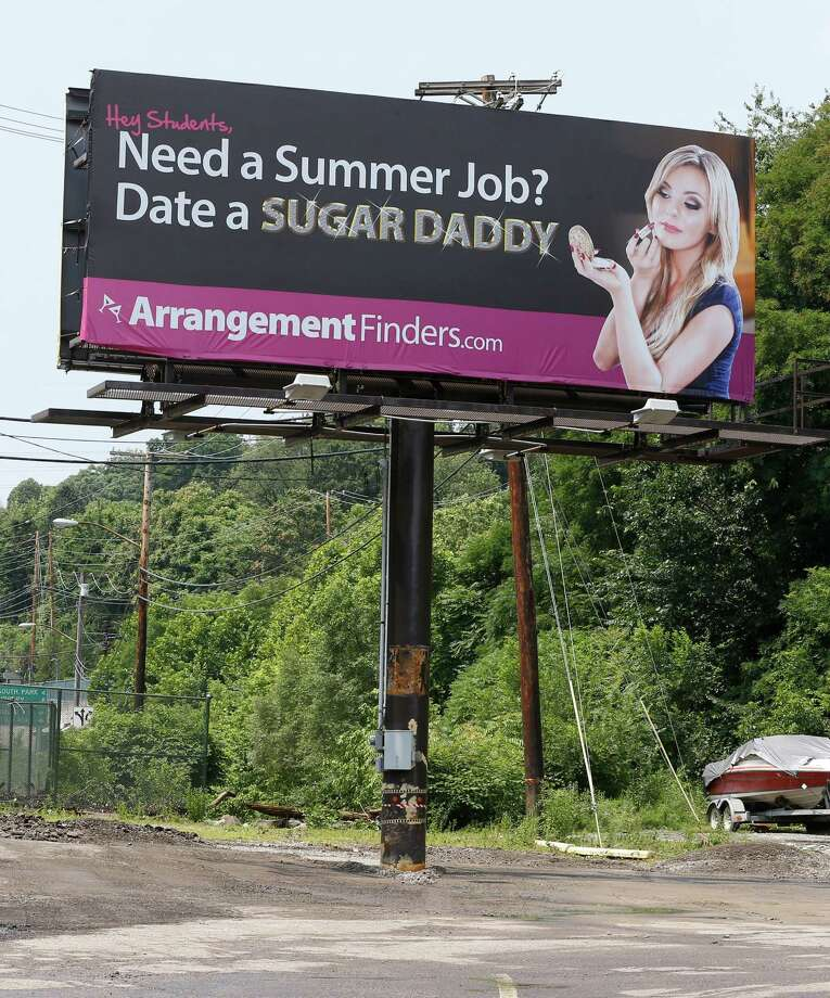 """A billboard that a Toronto company says is meant to connect female college students with """"sugar daddies"""" who pay a fee to join its website service is seen on Wednesday, July 10, 2013, in Pittsburgh. Pennsylvania State police Cpl. Raymond Schafer, who works for a western Pennsylvania vice squad, confirmed the ads are legal because, as Perkins contends, they don't include a direct offer of money for sex. Photo: AP"""
