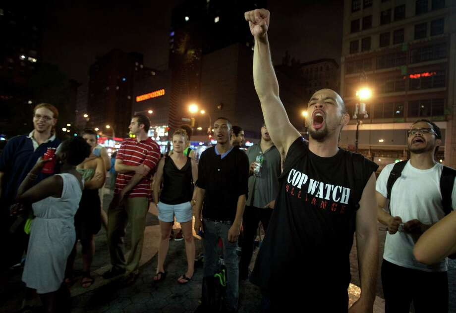 A man screams during a demonstration in Union Square after the news that George Zimmerman was found not guilty in the 2012 shooting death of teenager Trayvon Martin on Saturday, July 13, 2013 in New York. Photo: AP