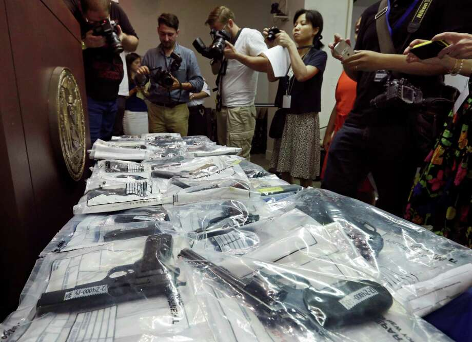 Guns seized during arrest of members of the Bonanno crime family are displayed at a news conference,  Tuesday, July 9, 2013. Nine people have been indicted on enterprise corruption charges. Photo: AP