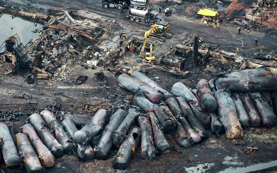 Workers comb through debris Tuesday, July 9, 2013, after a train derailed Saturday causing explosions of railway cars carrying crude oil in Lac-Megantic, Quebec. Photo: AP