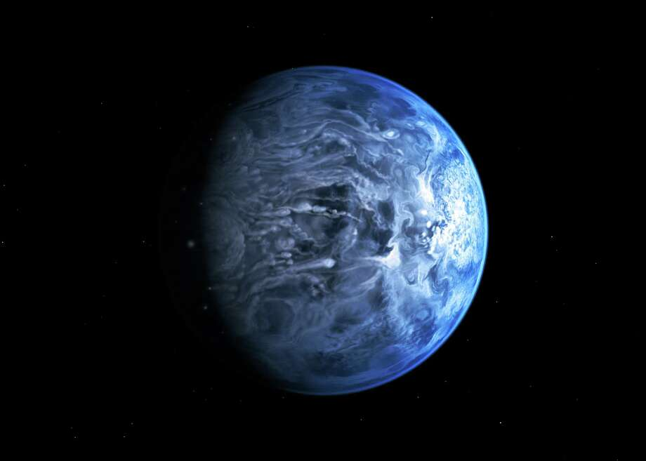 In this undated illustration provided by the European Space Agency (ESA), an artists impression of one of Earth's nearest planets outside the solar system named HD 189733B. Astronomers said Friday, July 12, 2013 that for the first time they had gained an understanding of HD 189733B, which is around 63 light years away by discovering the huge gas giant's blue color. To ascertain the planet's color the astronomers measured the amount of light reflected of its surface as it eclipsed its host star. Photo: AP