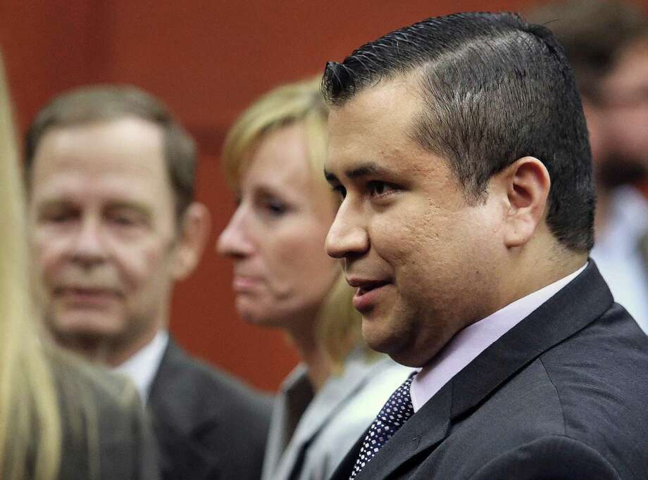 George Zimmerman leaves court with his family after Zimmerman's not guilty verdict was read in Seminole Circuit Court in Sanford, Fla. on Saturday, July 13, 2013. Jurors found Zimmerman not guilty of second-degree murder in the fatal shooting of 17-year-old Trayvon Martin in Sanford, Fla. Photo: AP