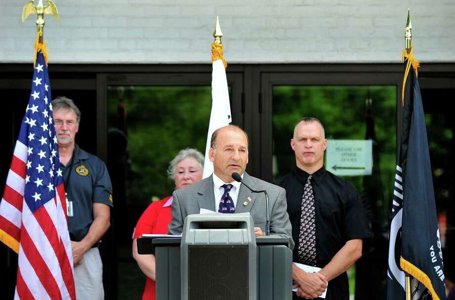 Lee Teicholz, project organizer, speaks, as the Veterans Walkway of Honor dedication ceremony takes place at the Danbury War Memorial, in Danbury, Conn. Sunday, July 14, 2013. Photo: Michael Duffy / The News-Times