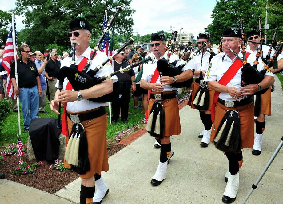 The Celtic Cross Pipes and Drums of Danbury, including Don Hicks, left, open the Veterans Walkway of Honor dedication ceremony at the Danbury War Memorial, in Danbury, Conn. Sunday, July 14, 2013. Photo: Michael Duffy / The News-Times