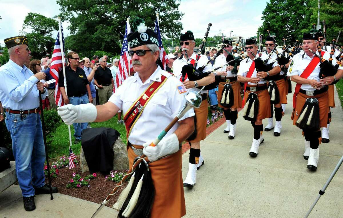 The Celtic Cross Pipes and Drums of Danbury open the Veterans Walkway of Honor dedication ceremony at the Danbury War Memorial, in Danbury, Conn. Sunday, July 14, 2013.