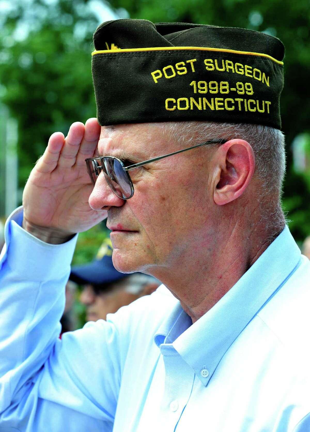 Wayne Dengler, a Vietnam veteran, salutes, as the Veterans Walkway of Honor dedication ceremony takes place at the Danbury War Memorial, in Danbury, Conn. Sunday, July 14, 2013.