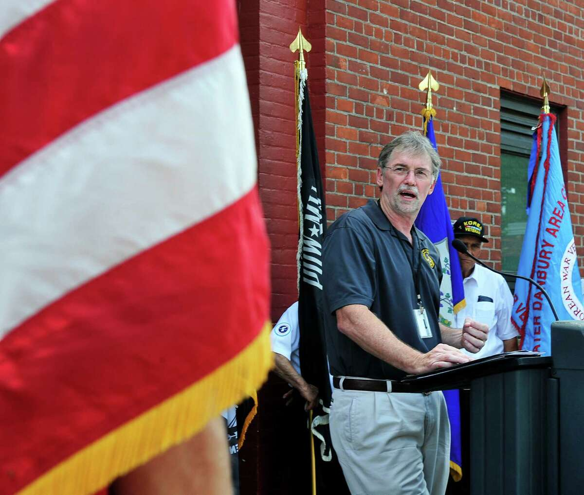 Thomas Quinn, of the U.S. Department of Vereran Affairs, is the guest speaker, as the Veterans Walkway of Honor dedication ceremony takes place at the Danbury War Memorial, in Danbury, Conn. Sunday, July 14, 2013.