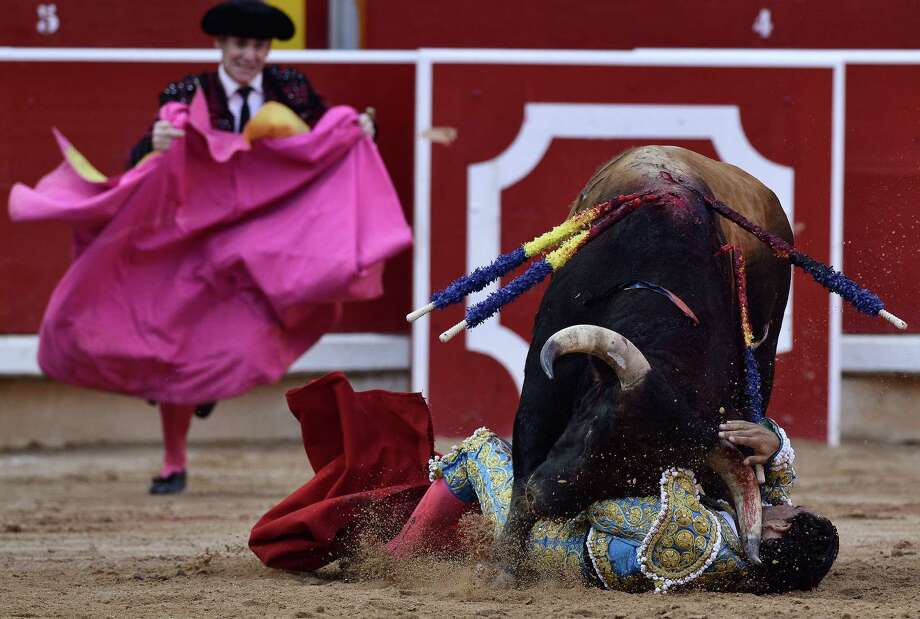 Spanish bullfighter Ivan Fandino, is gored by one Torrestrella' ranch bull,  in the bull ring, at the San Fermin fiestas, in Pamplona northern Spain on Thursday, July 11, 2013. Photo: AP