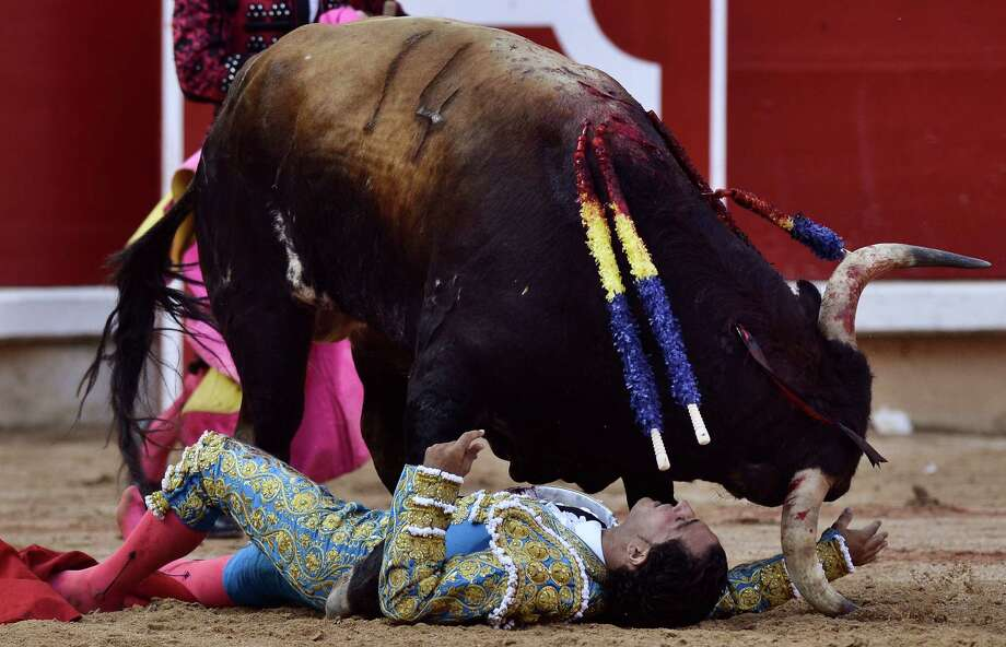 Spanish bullfighter Ivan Fandino, is gored by a Torrestrella' ranch bull,  in the bull ring, at the San Fermin fiestas, in Pamplona northern Spain on Thursday, July 11, 2013. Photo: AP