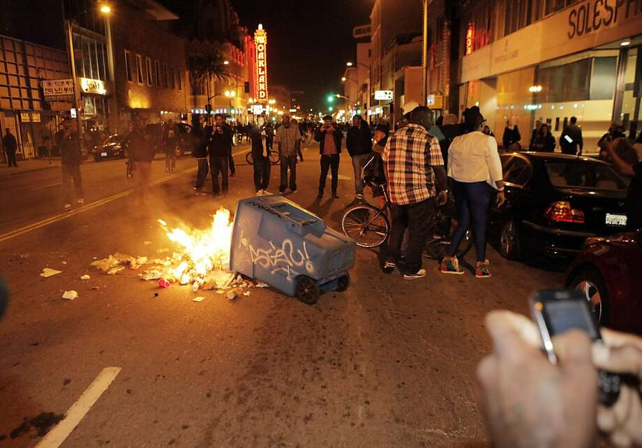Protesters set fires and vandalized stores in downtown Oakland on Saturday after the acquittal of George Zimmerman in the death of Trayvon Martin earlier in the day. Photo: Carlos Avila Gonzalez, The Chronicle