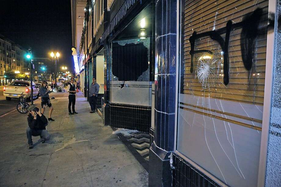 Graffiti and smashed glass remain at Flora and Fauna on Telegraph Avenue after protesters set fires and vandalized stores in downtown Oakland. Photo: Carlos Avila Gonzalez, The Chronicle