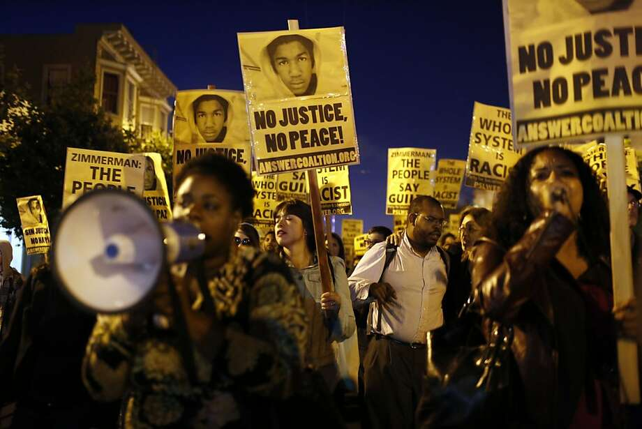 Protestors march down Valencia Street during protests in San Francisco's Mission District after George Zimmerman was found not guilty in the death of Trayvon Martin. Photo: Ian C. Bates, The Chronicle