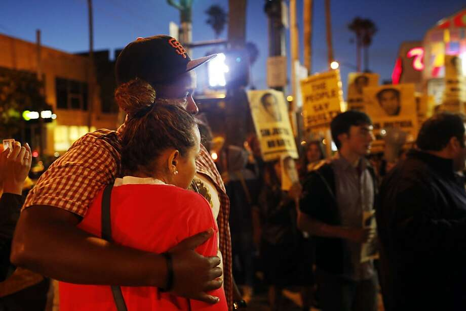 Percy and Genevieve Humphrey embrace during protests in the Mission after George Zimmerman was found not guilty in the death of Trayvon Martin. Photo: Ian C. Bates, The Chronicle