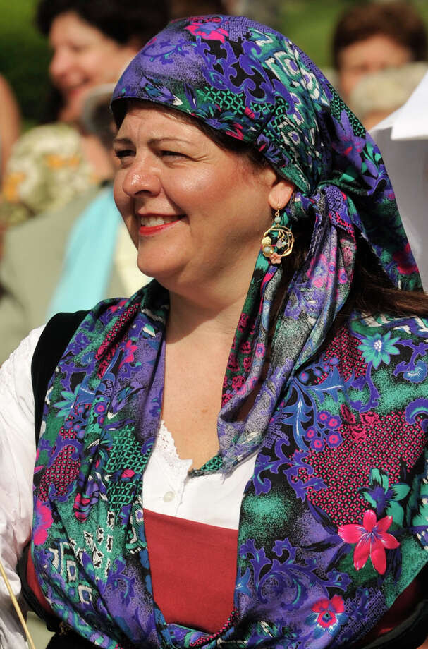 Pia Romano dresses up for the Minturnese community's tenth annual Sagra delle Regne, or harvest festival, procession in Stamford on Sunday, July 14, 2013. The Stamford festival is celebrated simultaneously with its sister city of Minturno, Italy, Photo: Jason Rearick / Stamford Advocate