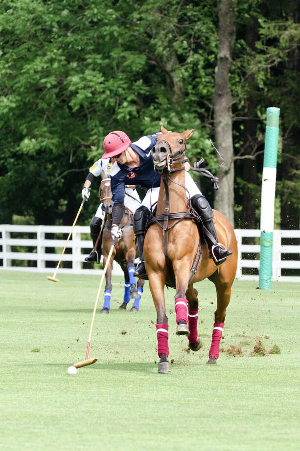 Cinque Terre's Joao Ganon during the first annual Virginia House of Hope charity polo match fundraiser at the Greenwich Polo Club at Conyers Farm on Hurlingham Drive in Greenwich on Sunday, July 14, 2013. Photo: Amy Mortensen / Connecticut Post Freelance