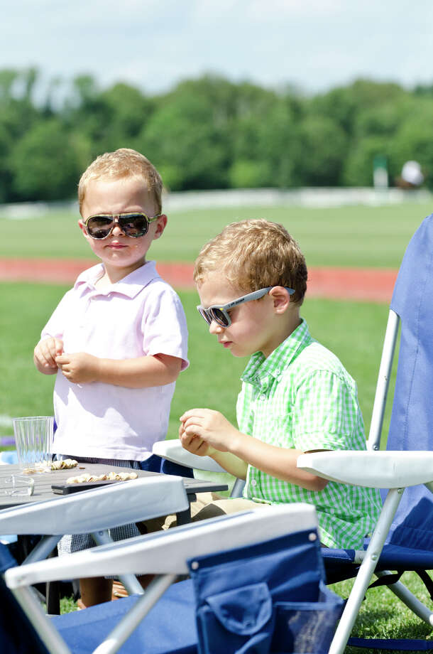 Max Gentile, 2, and his brother, Luke Gentile, 4, of Greenwich, enjoy pistachios on the sidelines during the first annual Virginia House of Hope charity polo match fundraiser at the Greenwich Polo Club at Conyers Farm on Hurlingham Drive in Greenwich on Sunday, July 14, 2013. Photo: Amy Mortensen / Connecticut Post Freelance