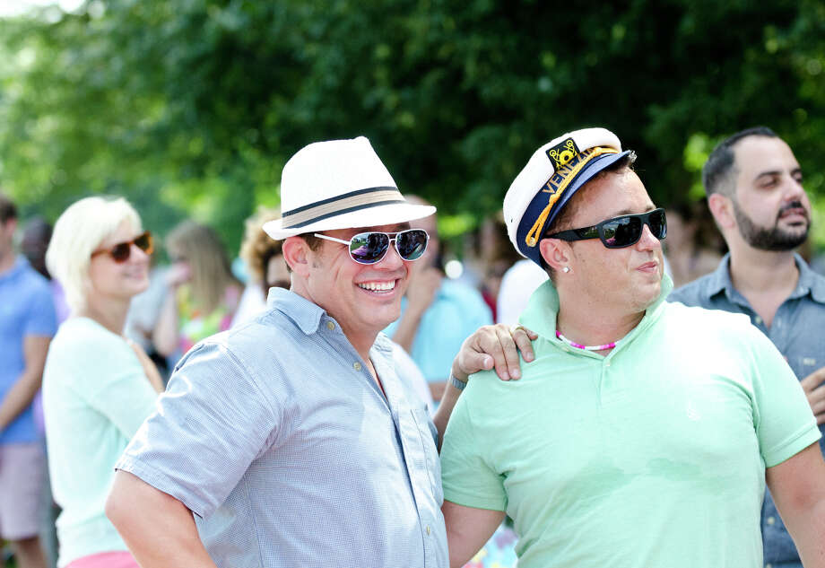 Keith Thompson, of Stamford, at left, stands with Dave Ganalo, of New Canaan, during the first annual Virginia House of Hope charity polo match fundraiser at the Greenwich Polo Club at Conyers Farm on Hurlingham Drive in Greenwich on Sunday, July 14, 2013. Photo: Amy Mortensen / Connecticut Post Freelance
