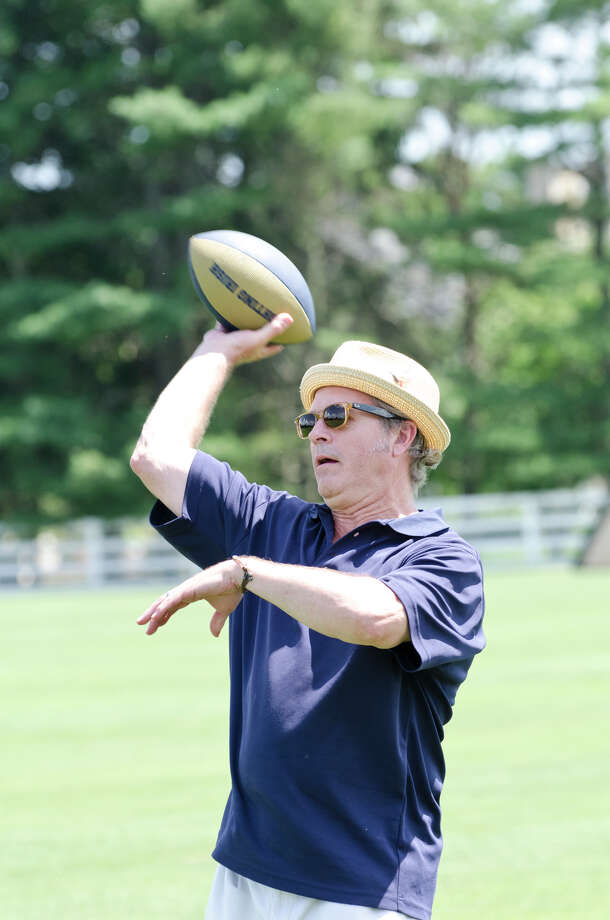 Mark Cook, of Greenwich, throws a football during the first annual Virginia House of Hope charity polo match fundraiser at the Greenwich Polo Club at Conyers Farm on Hurlingham Drive in Greenwich on Sunday, July 14, 2013. Photo: Amy Mortensen / Connecticut Post Freelance