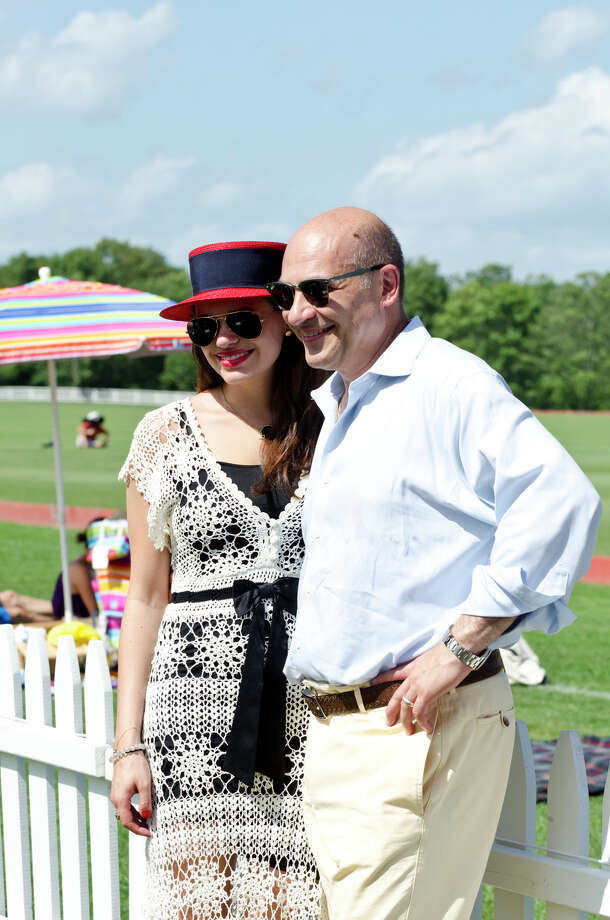 Stephan Skoufalos, of Old Greenwich, stands with his daughter, Cassandra Skoufalos, 23, during the first annual Virginia House of Hope charity polo match fundraiser at the Greenwich Polo Club at Conyers Farm on Hurlingham Drive in Greenwich on Sunday, July 14, 2013. Photo: Amy Mortensen / Connecticut Post Freelance