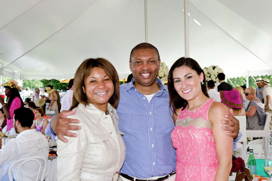 The Virginia House of Hope team from left, Sabine Poisson, Event Producer; Antonio Litman, Founder; Sophia Gangei, Executive Director; pose for a photo during the first annual Virginia House of Hope charity polo match fundraiser at the Greenwich Polo Club at Conyers Farm on Hurlingham Drive in Greenwich on Sunday, July 14, 2013. Photo: Amy Mortensen / Connecticut Post Freelance
