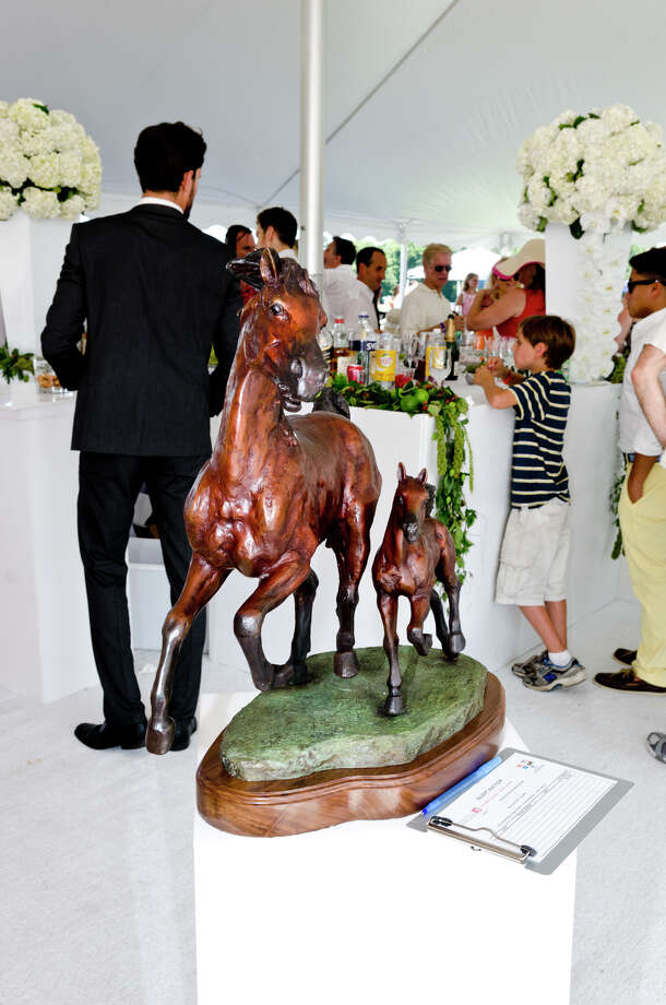 A bronze horse sculpture on display in the auction tent during the first annual Virginia House of Hope charity polo match fundraiser at the Greenwich Polo Club at Conyers Farm on Hurlingham Drive in Greenwich on Sunday, July 14, 2013. Photo: Amy Mortensen / Connecticut Post Freelance